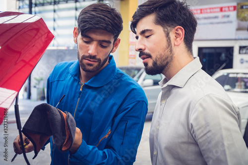 Fototapety, obrazy: Mechanic checking car with the owner. Auto services concepts