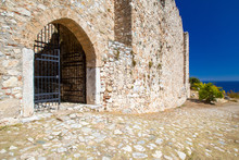 Greece. Fragment Of An Ancient Stone Fortress NEA Fokea. Cassandra. Chalkidiki. Metal Gates In The Fortress Wall. Sights Of Greece. Trip To Greece. An Ancient Fortress On The Seashore.