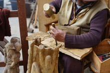 Old Hands Carving Wood With A ...