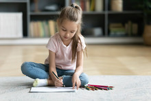 Preschooler Little Girl Drawing In Living Room