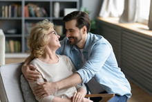 Happy Senior Mom And Adult Son Enjoy Time Talking
