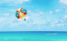 Scenic View On Tropical Coastline And Ocean With Parasailing.