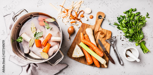 Fototapeta Cooking - chicken stock (broth or bouillon) with vegetables obraz