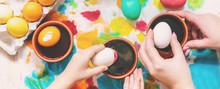 Family Paints Easter Eggs. Sel...