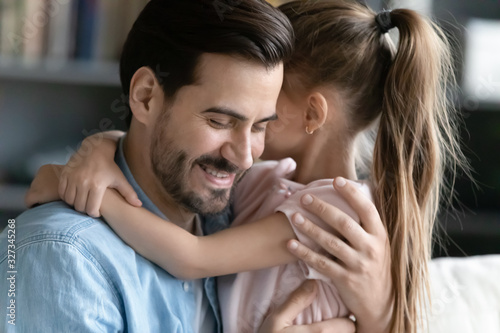 Caring little girl embrace young father showing love Wallpaper Mural