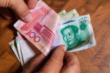 Male Hand Shows Renminbi Or Ch...