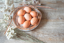 Brown Eggs On A Plate With Whi...