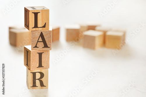 Four wooden cubes arranged in stack with text LAIR (meaning Listen, Acknowledge, Canvas Print