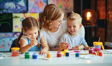 Mother And Children Son  And Daughter Painting Draws In Creativity In Kindergarten.