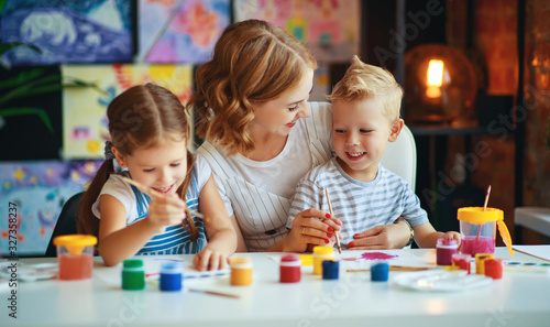 Fototapeta mother and children son  and daughter painting draws in creativity in kindergarten. obraz