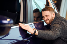 . Love At First Sight, Cheerful Customer Enjoying Bought Car, Happiness, Delight, Positive Feeling And Emotion. Funny Guy Striking His Own Car , Close Up Photo