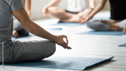 Valokuva Yoga coach and session participants meditating close up concept image