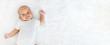 Leinwandbild Motiv Portrait newborn baby happy over white background, topview