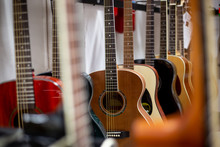Close Up Of Classic Guitar Drapped In A Row In A Huge Musical Shop, Instrument Shop, Instrument Concept