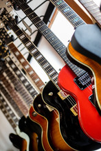 Close Up Of Professional Electric Guitar Drapped In A Row In A Huge Instrument, Musical Shop, Instrument Concept