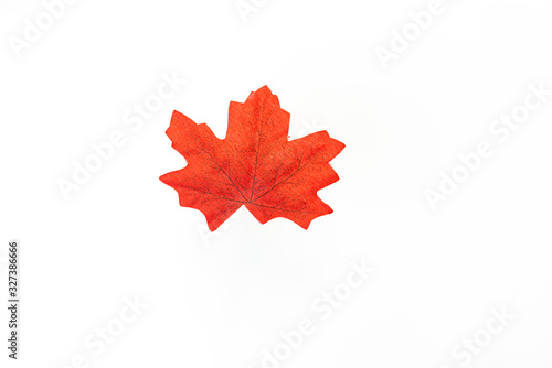 Photo plastic artificial  maple leaf made from fabric isolated on white background