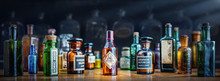 A Bottle Of Poison On A Background Of Old Medical, Chemistry And Pharmacy Glass. Chemistry And Pharmacy History Panoramic Concept Background. Retro Style.
