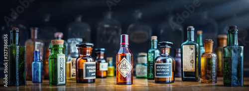 A bottle of poison on a background of old medical, chemistry and pharmacy glass Wallpaper Mural