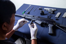 Gunsmith Cleaning Gun Rifle An...