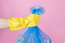 Cropped Close Up Photo Of Hand Holding Full Garbage Bag Isolated Background