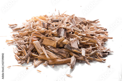Obraz na plátne Small pile of wood chips biomass for heating industrial boilers isolated on a white background