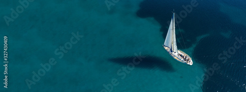 Aerial drone ultra wide photo of beautiful sail boat sailing in tropical exotic Fototapete