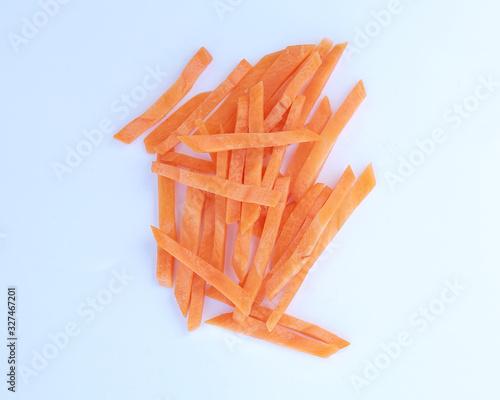Fototapeta Close-up Chopped and sliced carrot on white background. obraz
