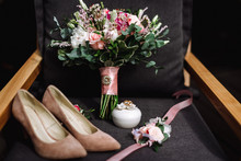 Wedding Accessories. Bride's Shoes, Wedding Rings, Boutonniere On A Chair