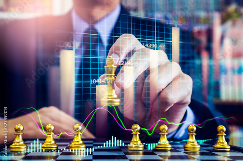Obraz Chess game on chess board on stock market or forex trading graph chart for financial investment concept. Economy trends for digital business marketing strategy analysis. Abstract finance background. - fototapety do salonu
