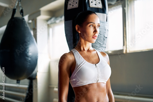Fotografie, Tablou Young sporty woman in fitness bra with sweat water drop on skin after workout