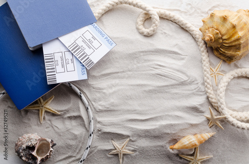 Top view of passports, airline tickets, marine rope, shell, strafish on the soft light sand Wallpaper Mural