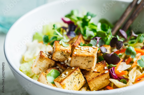 Fried tofu salad with sprouts and sesame seeds in white bowl Fototapeta