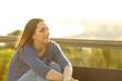 Leinwanddruck Bild - Satisfied woman looking away on a park