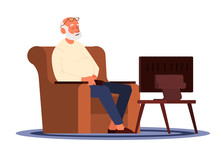 Old Man Sitting In An Armchair And Watching TV. Old People Lifestyle