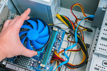 Installing A Processor Fan On The Computer Motherboard. Computer Repair, PC Assembly