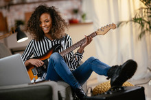 African Woman With Guitar. Beautiful Woman Playing Guitar.
