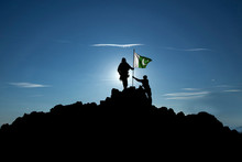 Two Soldiers Raise The Pakistani Flag