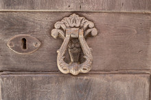 Old Metal Door Handles With A Beautiful Metal Ornament On A Wooden Background