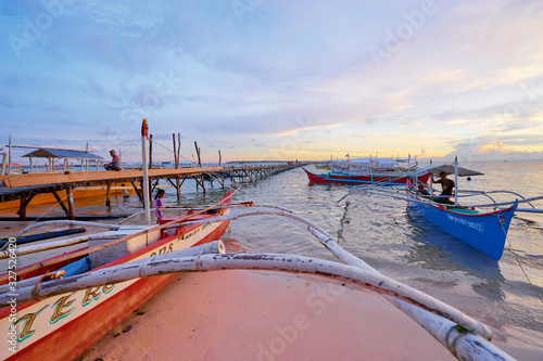 Fototapety, obrazy: Beautiful colorful sunset on the seashore with fishing boats. Philippines, Siargao Island.