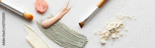 Top view of face powder, clay, cosmetic and tone cream brushstrokes, brushes and Canvas Print