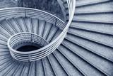 Fototapeta Na drzwi - Empty modern spiral stairway, viewed from top
