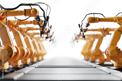 Photo Robotic arms along assembly line. Modern heavy industry
