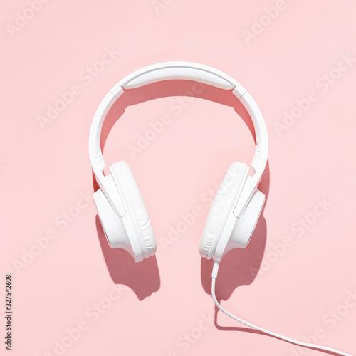 Obraz na plátně Flat lay white headphones on modern pale pink table wallpaper