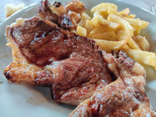 Entrecote Detail With French Fries In Horizontal