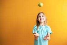 Cute Baby On An Orange Backgro...