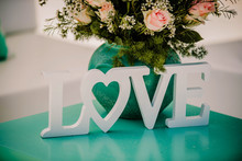 Wooden Love Word Sign On A Celebration