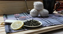 Dry Green Tea, A Slice Of Lemon, Marshmallows And Items For Tea In The Cozy Kitchen