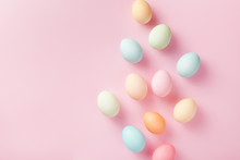 Pastel Easter Eggs On Pink Background Top View. Flat Lay Style.