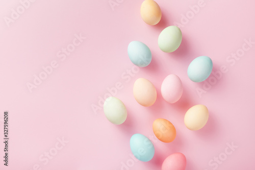 Obraz Pastel Easter eggs on pink background top view. Flat lay style. - fototapety do salonu