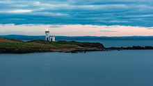 Elie Cloudy Sunset With Lighth...
